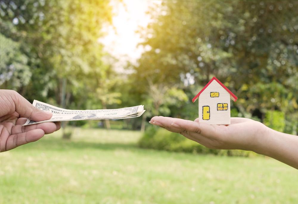 家の模型とお金の交換